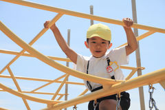 Japanese boy on the jungle gym Stock Photography