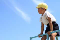 Japanese boy on the jungle gym Royalty Free Stock Images