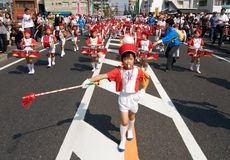 Japanese boy leads children's marching band. KAGOSHIMA CITY, JAPAN - OCTOBER 22: A young boy leads a children's marching band  during the Taniyama Furusato Royalty Free Stock Photos
