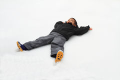 Japanese boy lying on the snow field Stock Image