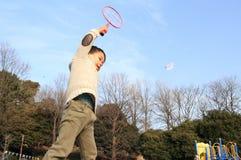 Japanese boy playing badminton Royalty Free Stock Images
