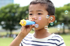 Japanese boy playing with bubble royalty free stock image
