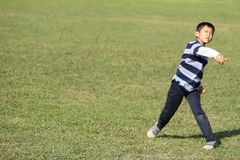 Japanese boy playing catch Stock Image