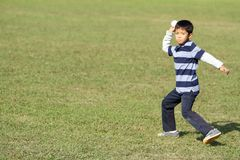 Japanese boy playing catch Royalty Free Stock Images