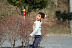 Japanese boy playing catch Royalty Free Stock Photography