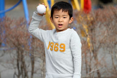 Japanese boy playing catch Stock Images