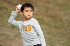 Japanese boy playing catch Stock Photography