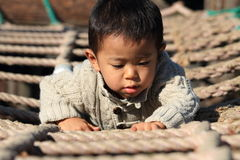 Japanese boy playing at field athletic Stock Images
