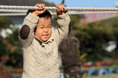 Japanese boy playing at field athletic Royalty Free Stock Photography