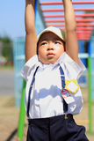 Japanese boy playing with a monkey bars Stock Photography