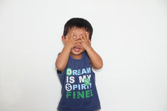 Japanese boy playing peek-a-boo Royalty Free Stock Photos
