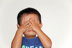 Japanese boy playing peek-a-boo Royalty Free Stock Photo