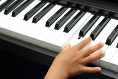 Japanese boy playing a piano. (5 years old stock images