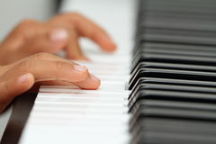 Japanese boy playing a piano Stock Photography