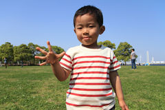 Japanese boy playing with rock-scissor-paper Stock Photo