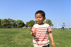 Japanese boy playing with rock-scissor-paper Royalty Free Stock Photo