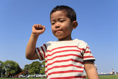Japanese boy playing with rock-scissor-paper Stock Image