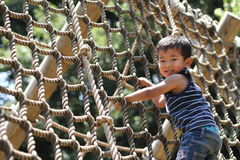 Japanese boy playing with rope ladder Stock Photography