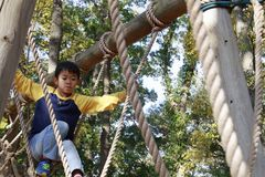 Japanese boy playing with ropewalking royalty free stock images