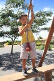 Japanese boy playing with Tarzan rope Royalty Free Stock Image
