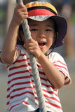 Japanese boy playing with Tarzan rope Royalty Free Stock Photography