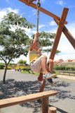 Japanese boy playing with Tarzan rope Royalty Free Stock Photo