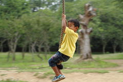Japanese boy playing with Tarzan rope Royalty Free Stock Images