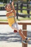 Japanese boy playing with Tarzan rope Stock Photo