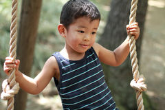 Japanese boy playing with tightrope Stock Photo