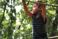 Japanese boy playing with tightrope Stock Images