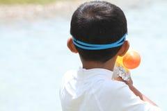 Japanese boy playing with water gun Stock Photos