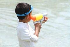 Japanese boy playing with water gun Royalty Free Stock Image