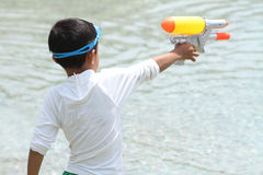 Japanese boy playing with water gun Royalty Free Stock Images