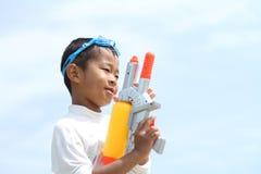 Japanese boy playing with water gun Royalty Free Stock Photos