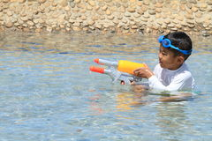 Japanese boy playing with water gun Royalty Free Stock Image