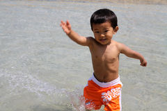 Japanese boy playing with water Royalty Free Stock Images