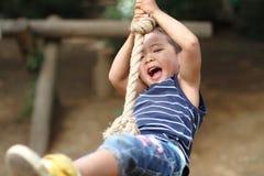 Free Japanese Boy Playing With Tarzan Rope Stock Photo - 47653860