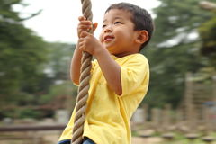 Free Japanese Boy Playing With Tarzan Rope Stock Photography - 48383602