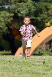 Japanese boy running on the grass in summer. Japanese boy running on the grass 3 years old in summer Royalty Free Stock Image