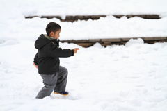 Japanese boy running on the snow field Royalty Free Stock Photos
