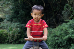 Japanese boy on the seesaw Royalty Free Stock Photos