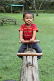 Japanese boy on the seesaw Royalty Free Stock Photo
