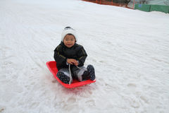 Japanese boy on the sled Royalty Free Stock Photo