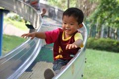 Japanese boy on the slide Stock Image