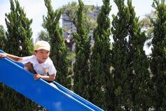 Japanese boy on the slide Stock Photo