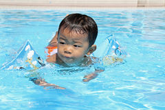 Japanese boy swiming in the pool. (1 year old Royalty Free Stock Photos
