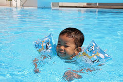 Japanese boy swiming in the pool. (1 year old Royalty Free Stock Images