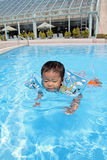 Japanese boy swiming in the pool Stock Photo