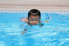 Japanese boy swiming in the pool. (1 year old Royalty Free Stock Photo