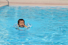 Japanese boy swiming in the pool. (1 year old Royalty Free Stock Image